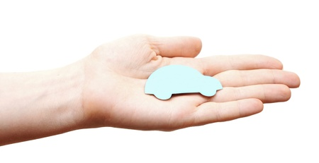 woman hands holding blue car isolated on white background  photo