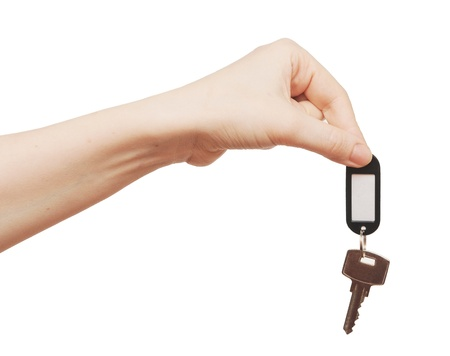 silver key with blank tag in hand isolated on white  space for your text Stock Photo - 13209932