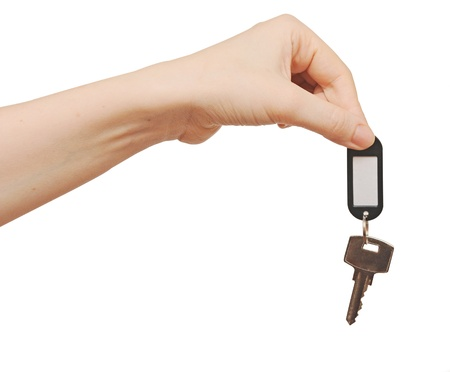 silver key with blank tag in hand isolated on white  space for your text photo