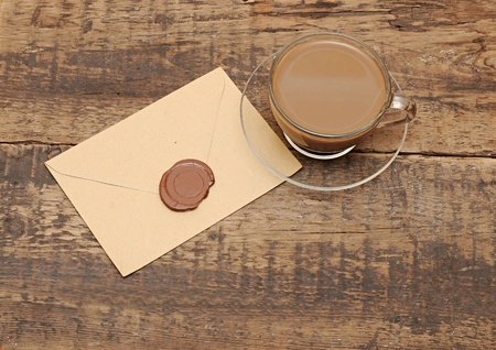 envelope with wax seal on coffee table photo