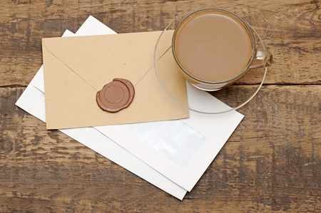 envelopes with wax seal on coffee table photo
