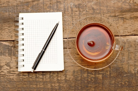 notebooks, pens, coffee on the table photo