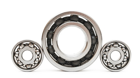 Big and small ball bearings on white background  photo