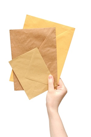 Hand with the envelope against the white background  Stock Photo - 13211571