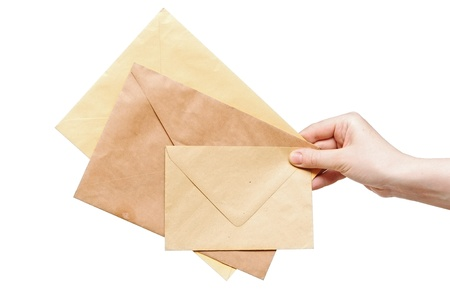 yellow envelopes in the hand isolated on white background photo