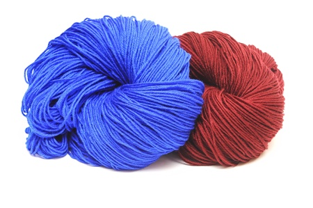 collection of wool knitting on white background photo