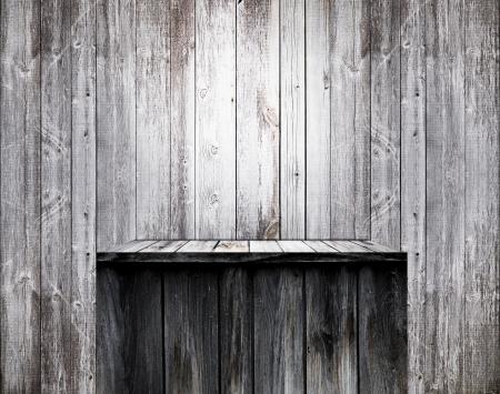 Empty wood shelf on old wall photo