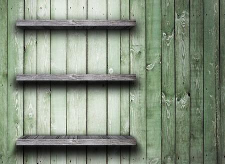 wood shelf: Estante de madera vieja en la pared de madera Foto de archivo