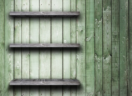 Old wood shelf on wooden wall