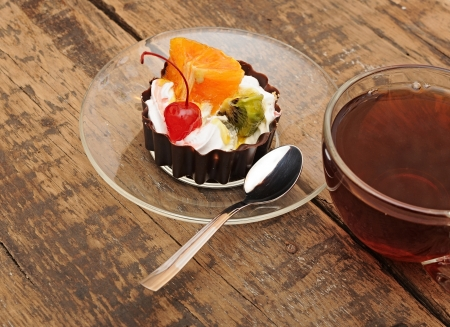 delicious cake with fruit and a cup of tea Stock Photo - 13628529