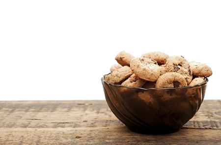 chocolate chip cookies in a cup on wooden table photo