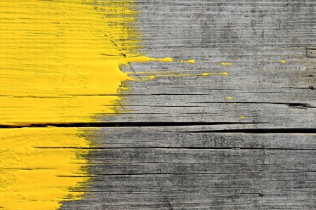yellow paint on old wooden background
