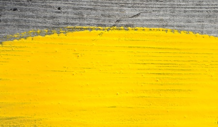 yellow paint on old wooden background photo