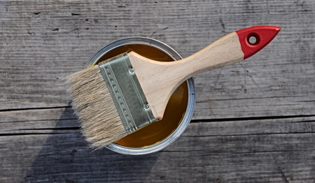 paint brush over paint can  Stock Photo - 13628484