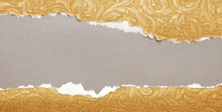 Torn paper - golden paper ripped apart showing underlying layer Stock Photo - 13773873