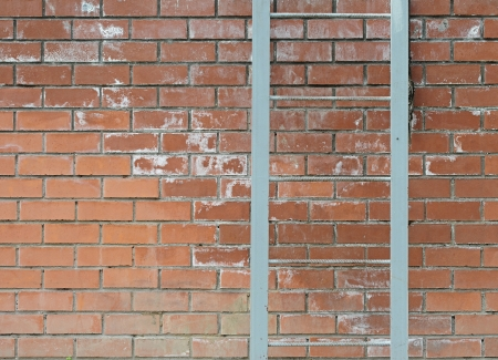 deliverance: Old metal ladder on a brick wall  Stock Photo