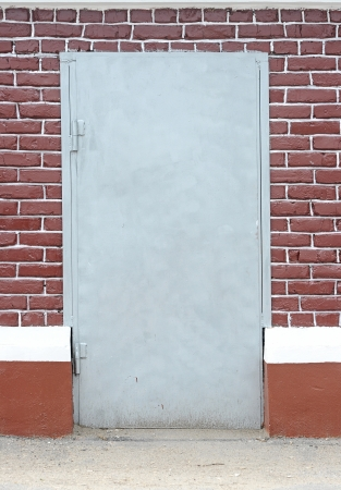 brick wall with door background Stock Photo - 13773839