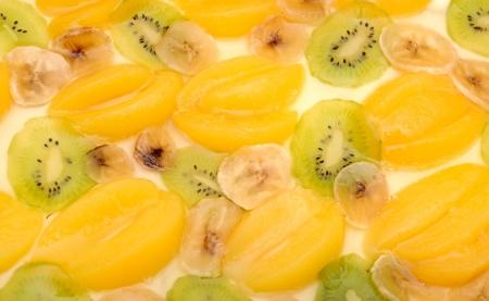 Fresh apricot cake with banana and kiwi photo