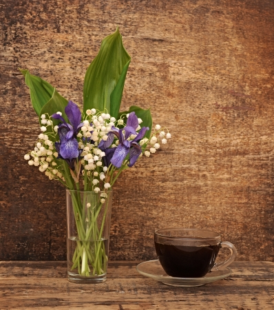 Still-life bouquet of lily of the valley  with blue irises Stock Photo