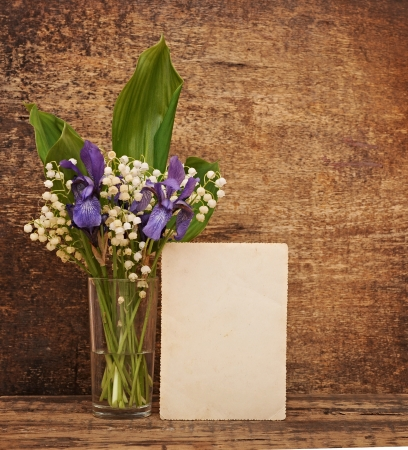 Still-life bouquet of lily of the valley  with blue irises photo