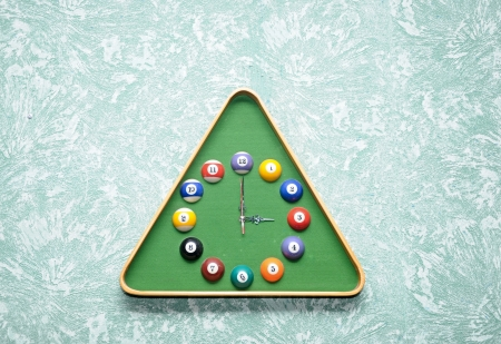 Wall clock in snooker hall in triangle frame shape  photo