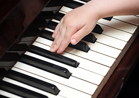 Piano playing hands of a child  photo