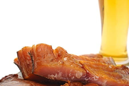 Smoked fish and cup of beer on a white background Stock Photo - 14260391