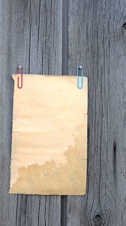 Writing old note paper on wood background  photo
