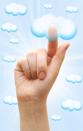 Woman hand touch the cloud against blue sky with clouds. finger touching the cloud