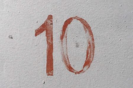 10 - old brown handwritten number over grunge silver background photo