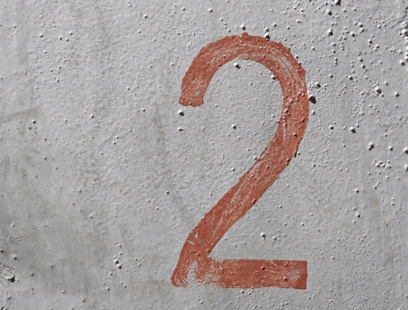 2 - old brown handwritten number over grunge silver background photo