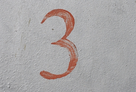 3 - old brown handwritten number over grunge silver background photo