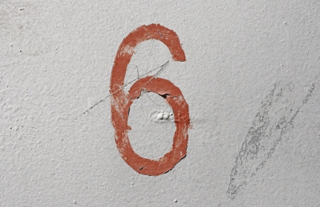 6 - old brown handwritten number over grunge silver background photo