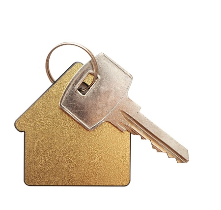 on the move: House shaped keychain isolated on white background