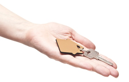 House keys in the female hand on a white background Stock Photo - 15127435
