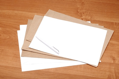 stack of envelopes on a brown table photo