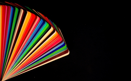 colorful color guide on black background with copy space