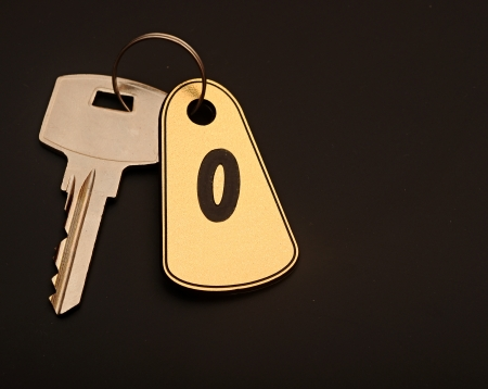 room key on black background with number 0 Stock Photo - 15400412