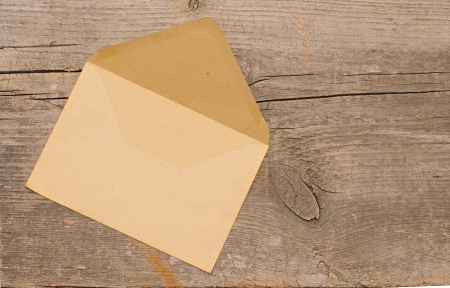 Old envelope on wooden background . With copy space photo