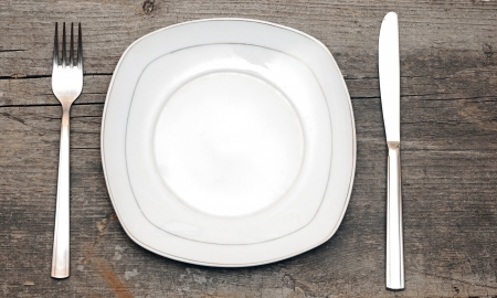 Empty dish knife and fork on wood table Stock Photo - 15738264
