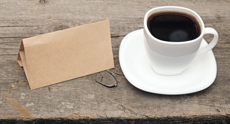 blank old paper with coffee cup on wooden background Stock Photo - 15738259