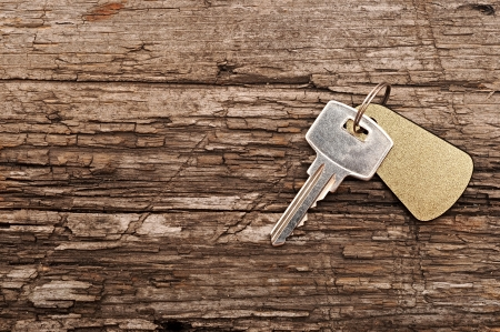 single key on a wooden table photo