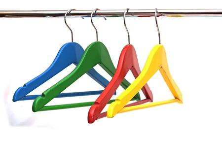 coat rack: colorful coats hanger isolated on white