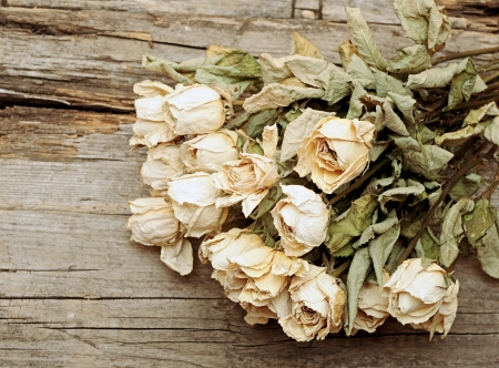 bouquet dried roses on old wood background with copy space Stock Photo - 15818194