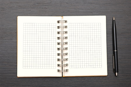 notebook and pen on dark wooden background Stock Photo - 15858894