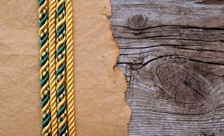 Vintage paper and color rope on old wooden boards  photo
