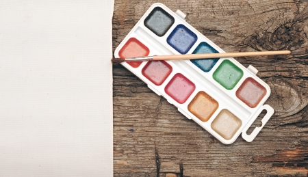 water-color, brush and palette with canvas on old wooden background Stock Photo - 16031845