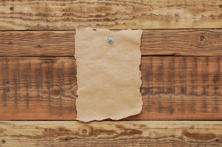 drawingpin: Old paper tacked to a wood wall