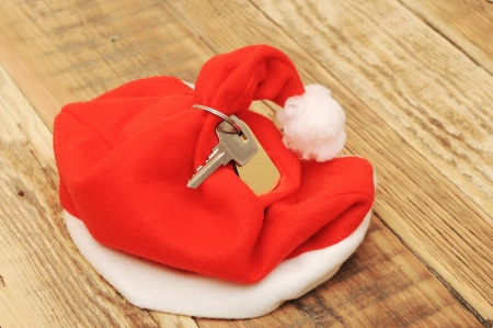 Santa's key with blank label  on old wooden table photo