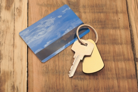 key with plastic card and reflection blue sky and clouds  photo
